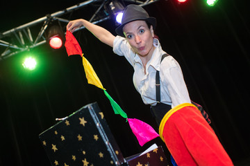 beautiful magician on circus arena stage