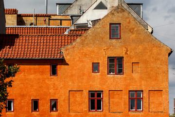 Orange House wall with windows in Christianshavn Copenhagen Denmark