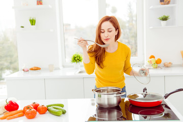 Lady in yellow pullover, with tomato, cucumber, pepper, cabbage,