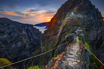 Madeira, Portugal. Hiking path between Pico do Arieiro and Pico do Ruivo at sunset above the clouds Fototapete