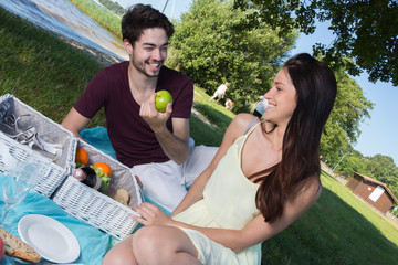 portrait of young couple during romantic picnic in countryside