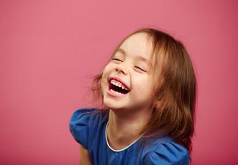 Joyful laughter of children girls with sincere look.