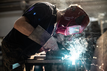 Welding steel tubes with sparks and smoke