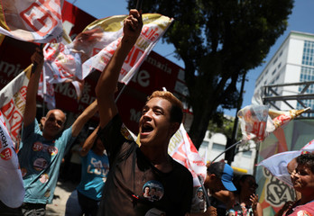 Supporters of Brazil's Workers' Party presidential candidate Haddad attend a rally in Rio de Janeiro