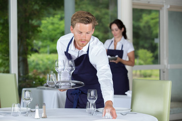 young worker table setting