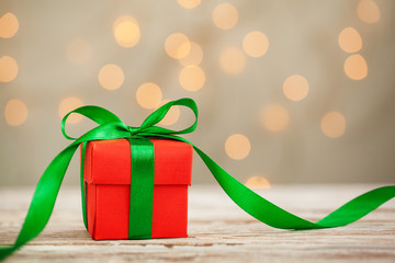 One red christmas gift box with green ribbon and copy space.