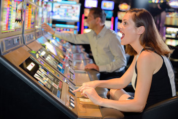 Woman cheering encouragement to arcade machine