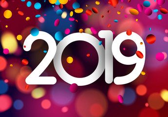 Bright blurred 2019 New Year card with colorful confetti.