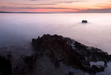 Rocky Coastline with Pastel Color Sky in Croatia