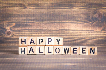 happy halloween. Wooden letters on the office desk, informative and communication background