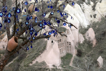 Traditional turkish amulet nazar boncugu (evil eye) tree in Pigeon valley, Cappadocia, Turkey.