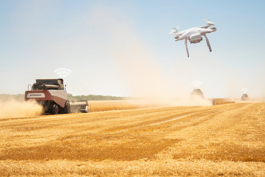 Autonomous combine harvesters with drone. Internet of things in agriculture.