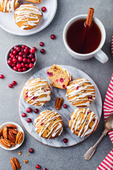 Muffins, cakes with cranberry and pecan nuts. Christmas decoration. Top view.