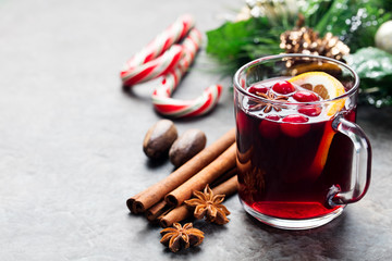 Mulled red wine with spices, orange slices. New year and Christmas background. Copy space.