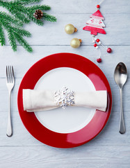 Christmas, New Year celebration place table setting. Wooden background. Top view.
