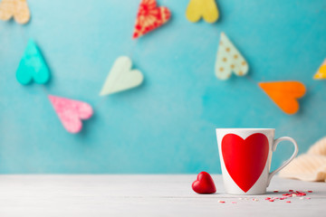 Romantic drink, coffee, latte, cappuccino with whipped cream and chocolate hearts. Blue background. Copy space.