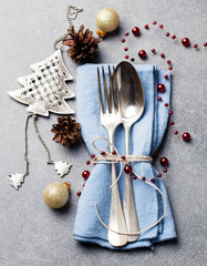 Christmas and New Year holiday table place setting decorations. Grey background. Top view.