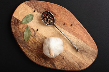 Spices and herbs on a wooden cutting board