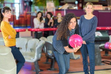 Woman poised to throw bowling ball