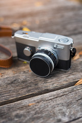 Old retro camera on a wooden background,Copy space