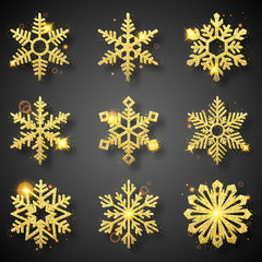 Collection of gold glitter snowflakes. Nine sparkling golden snowflakes with glitter texture. Winter holidays decoration