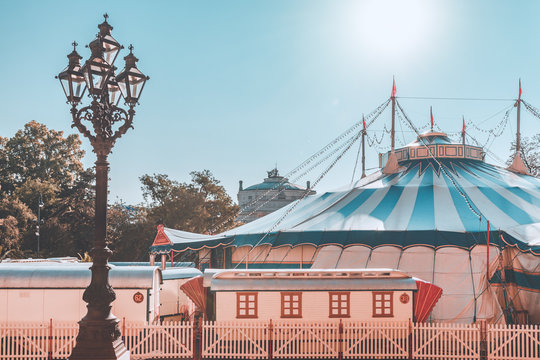 Vintage street lamp in front of  big top of circus