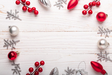 Silver and red christmas gifts on white wooden background. Top view