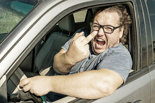 Angry fat man in the car. Road and stress