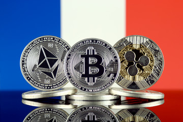 Physical version of Ethereum (ETH), Bitcoin (BTC), Ripple (XRP) and France Flag. The Top 3 Cryptocurrencies by Market Cap.