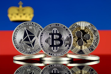 Physical version of Ethereum (ETH), Bitcoin (BTC), Ripple (XRP) and Lichtenstein Flag. The Top 3 Cryptocurrencies by Market Cap.