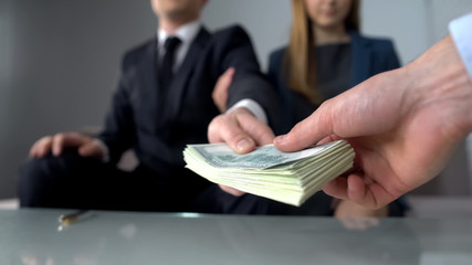 Couple giving bribe for illegal deal on real estate market, inheritance fraud