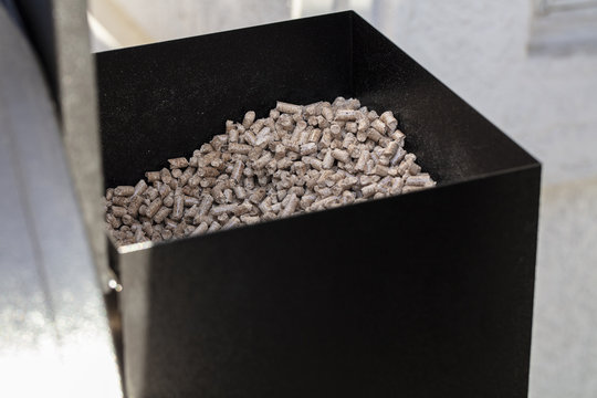 Wood pellets in a smoker pellet box for barbecue