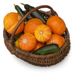 Ripe pumpkin and zucchini in wicker basket. Autumn concept