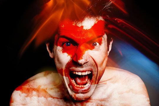 homme portrait visage furieux cri crier fou fête dingue lumière multicolor coloré vif tâche fiesta soirée festival clown techno regard colère indigné rage couleur