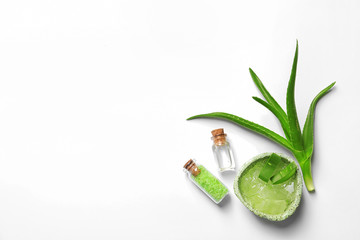 Flat lay composition with aloe vera on white background. Space for text