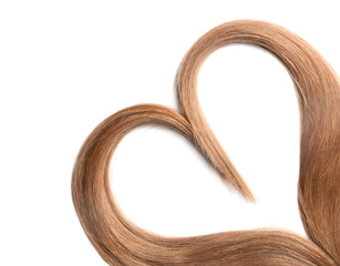 Heart made of brown hair locks on white background