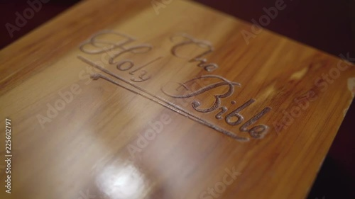 Close up of wooden book box labeled The Holy Bible