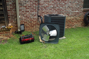 Air Conditioner Condenser coil with tools being repaired