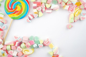 Creative arrangements of confectionery or candies on a white background. Flat lay.