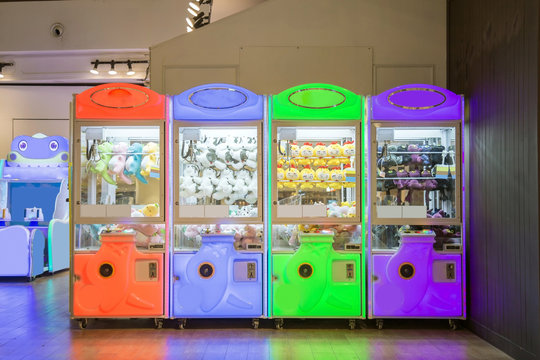 A multicolor claw machine games in department store.