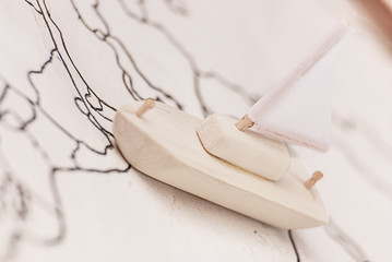 Journey on a small toy wooden ship