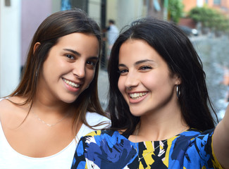 Two young women making selfie.