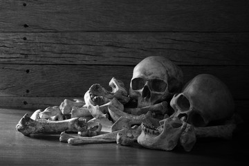 Awesome pile of three skull and bone on dark background in the morgue