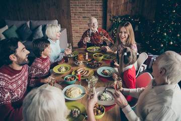 High above angle view of noel diverse family gathering. Cheerful