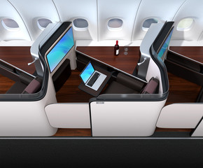 Luxury business class suite interior. Laptop connected to the monitor by Wi-Fi. 3D rendering image.