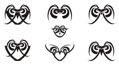Tribal black and white laconic owl icons. The decorative linear icons of owls formed by simple elements for your design