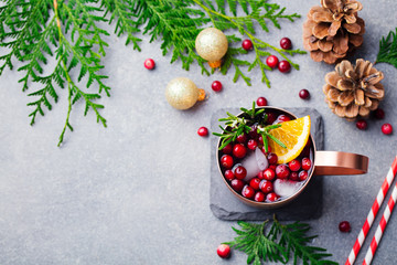Christmas Moscow mule, holiday drink in a copper mug. Grey stone background. Top view. Copy space.