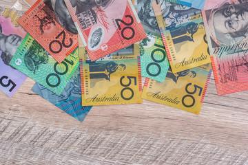 Australian dollars on wooden table as background