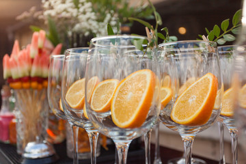 glasses decorated round slice of citrus fruit and olive branch