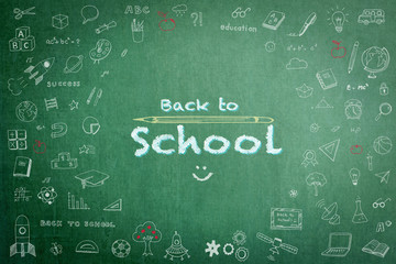 Educational back to school concept with doodle freehand white chalk drawing on green chalkboard